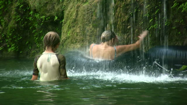 HD 1080i Family swimming under waterfall video