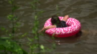 HD 1080i girl swim suit floating Texas water hole video