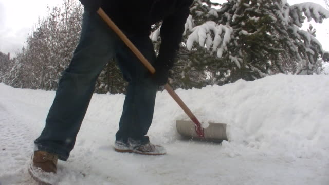 HD 1080i Man Shoveling Snow 2 video