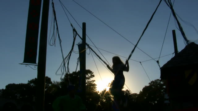 HD 1080i Silhouette of bungy trampoline jumping 8 video
