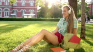 1080p Blond school girl listening to music video