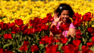 HD 1080p - Girl waves from field of Tulips video
