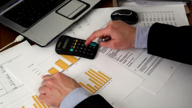 1080p HD businessman calculating video
