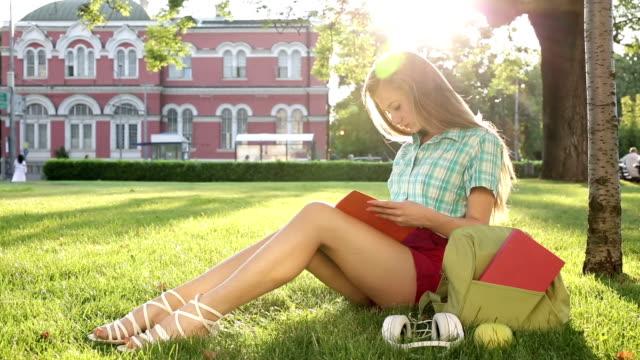 1080p School girl reading a textbook video