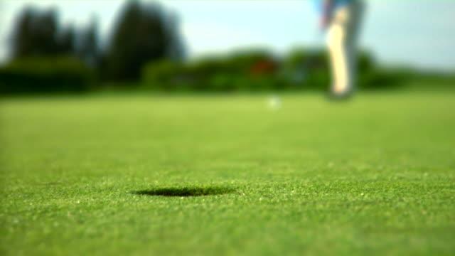 HD 1080p - Sinking a Long Golf Putt video