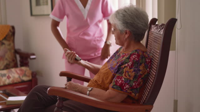 13-Hospice Nurse Helps Old Lady With Mobile Phone Call video