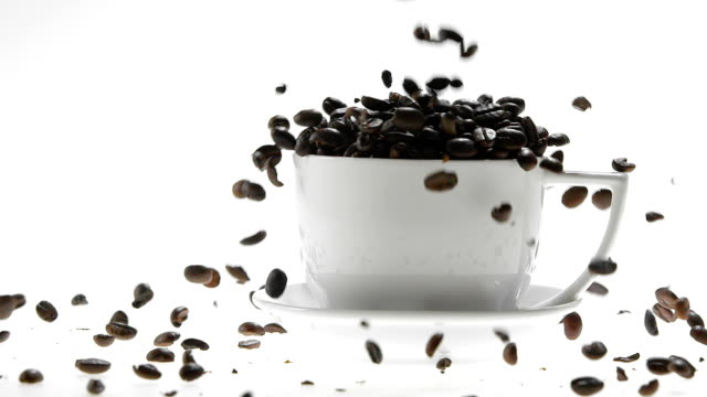180fps Super Slow Motion Coffee Seeds Falling into White Cup video