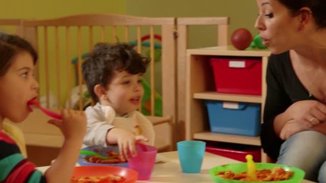 1of15 Little children, babies, educator, teacher eating in kindergarten, school video