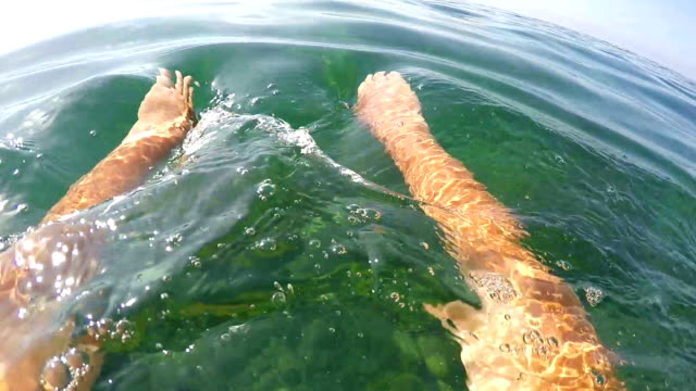 1st person POV of swimmer in sea water swimming frog style video