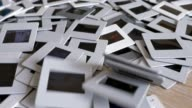 35mm Photographic Slides Falling into a Pile, Slow Motion video