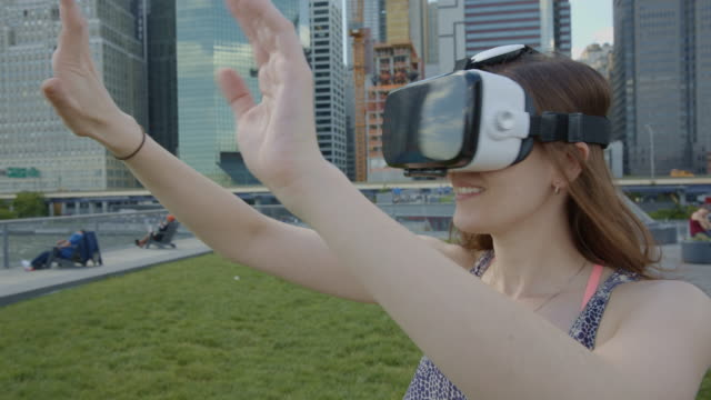 3d virtual reality googles headset simulator young woman playing NYC video