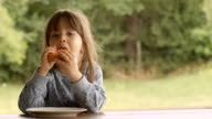 3-Year Old Child Enjoying Milk and French Toast on a Beautiful Summer Morning at The Porch video