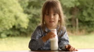 3-Year Old Child Enjoying Milk on a Beautiful Summer Morning at The Porch video