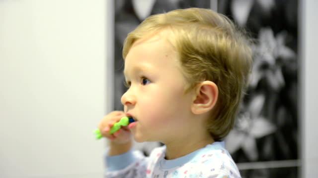 3-year-old boy brushing teeth video