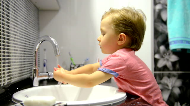 3-year-old boy washing his hands video