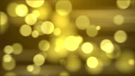 4k Abstract Gold Color Bokeh Background. Seamless Loop video