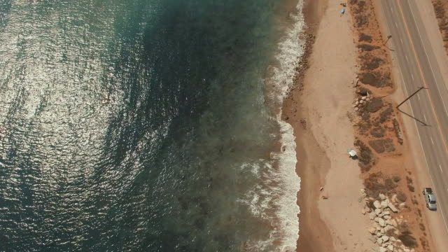 4k aerial pan up over a beach in Malibu, California video