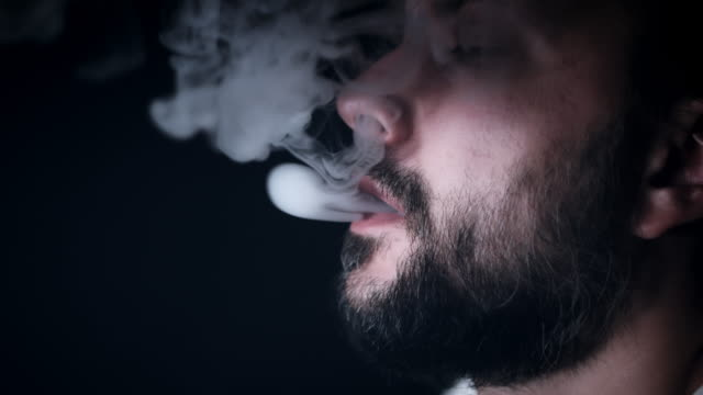 4k Arabic Man Close-up of Face with Smoke from Mouth video