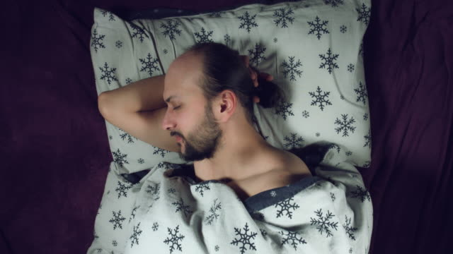 4k Authentic Shot of a Man in Bed Sleeping video