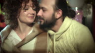 4k Christmas and New Year Holiday Couple Kissing and Smiling video