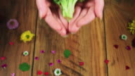 4k Colourful Composition of Fresh Broccoli in Hand - Wooden Background video