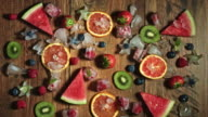 4k Colourful Composition of Fresh Fruits and Berries - Wooden Background video