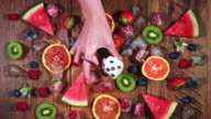 4k Colourful Composition of Fresh Fruits and Ice Cream - Wooden Background video