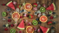 4k Colourful Composition of Fresh Fruits and Ice - Wooden Background video