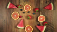 4k Colourful Composition of Fresh Fruits in time lapse - Wooden Background video