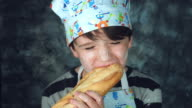 4k Colourful Shot of a Cook Child Biting and Eating Bread video