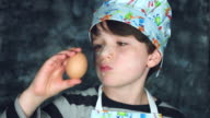 4k Colourful Shot of a Cook Child Checking and Analysing an Egg video
