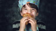 4k Colourful Shot of a Cook Child Eating Fast a Pancake video