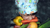 4k Colourful Shot of a Cook Child Holding a Carrot in his Mouth video