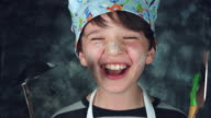 4k Colourful Shot of a Cook Child Holding Tools and Laughing out Loud video