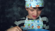 4k Colourful Shot of a Cook Child Looking at the Liquid for Pancakes video