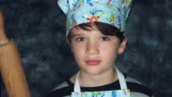4k Colourful Shot of a Cook Child Posing Funny with a Dough Roller video