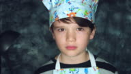 4k Colourful Shot of a Cook Child Posing Funny with a Ladle video
