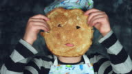 4k Colourful Shot of a Cook Child Posing Funny with a Pancake on Face video