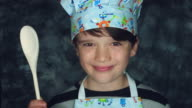 4k Colourful Shot of a Cook Child Posing Funny with a Spoon video