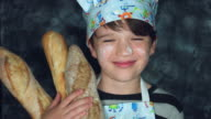 4k Colourful Shot of a Cook Child Posing Happy with Breads video