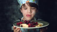4k Colourful Shot of a Cook Child Posing with a Plate of Pancakes for Dessert video