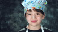 4k Colourful Shot of a Cook Child Putting a Pan on his Head video