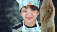 4k Colourful Shot of a Cook Child Showing Ciabatta Bread at Camera video