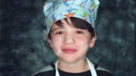 4k Colourful Shot of a Cook Child Showing Tasty or 'Bellissimo' video