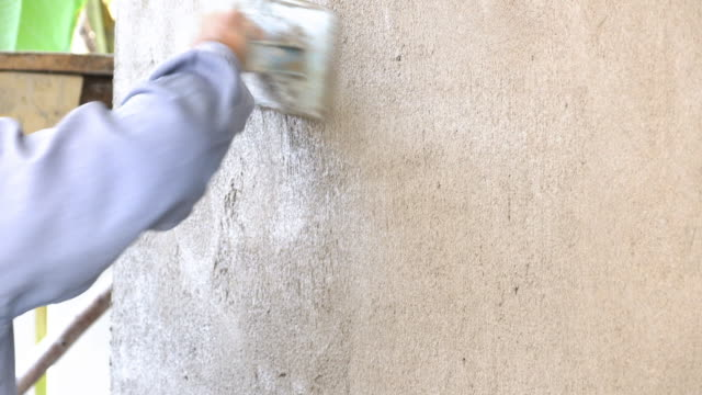 4k, construction worker plaster cement wall video