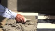 4k, construction worker tiling ceramic tiles floor video