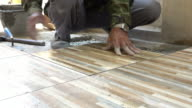4k, construction worker tiling ceramic tiles floor video