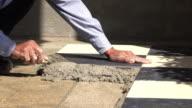 4k, construction worker tiling floor video