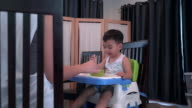 4k Dolly shot video of baby boy are eating breakfast video