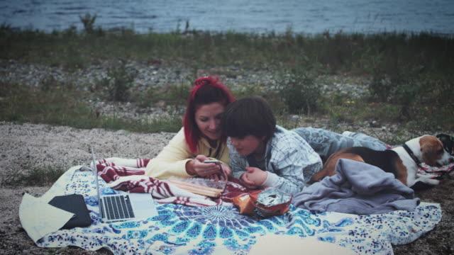 4k Family Having Picnic Next to the Lake video